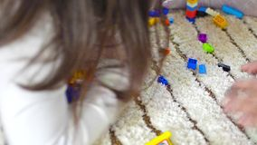 Children playing with toy bricks stock footage