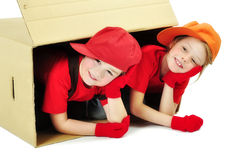 Children playing a toy house Royalty Free Stock Images