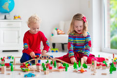 Children playing with toy railroad and train Stock Photography