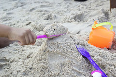 Children playing toy on sand Stock Photography