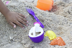 Children playing toy on sand Stock Image