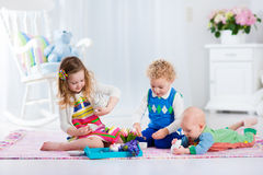 Children playing toy tea party Stock Images