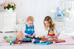 Children playing toy tea party Royalty Free Stock Image