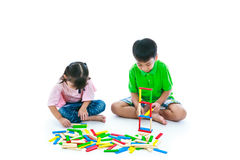 Children playing toy wood blocks, isolated on white background. Royalty Free Stock Images