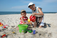Children playing with toys on the beach Stock Images