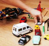 Children playing toys on floor at home, little hand in mess, fre. E education, lifestyle people concept Stock Photo