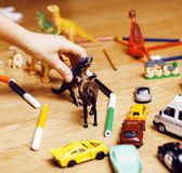 Children playing toys on floor at home, little hand in mess, fre. E education Stock Image