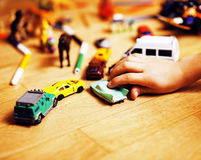 Children playing toys on floor at home, little hand in mess, fre Royalty Free Stock Photos