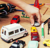 Children playing toys on floor at home, little. Hand in mess, free education Stock Image