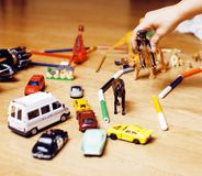 Children playing toys on floor at home, little hand in mess, free education. Lifestyle people concept Royalty Free Stock Photography