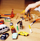 Children playing toys on floor at home, little hand in mess, free education Royalty Free Stock Photography