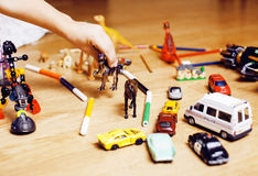Children playing toys on floor at home, little hand in mess, free education Royalty Free Stock Images