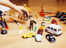 Children playing toys on floor at home, little hand in mess, free education Royalty Free Stock Image