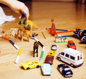 Children playing toys on floor at home, little hand in mess, free education Stock Photography