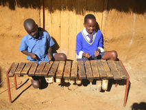 Children playing  traditional xylophone Royalty Free Stock Image