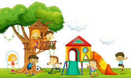 Children playing at the treehouse in the park Stock Image