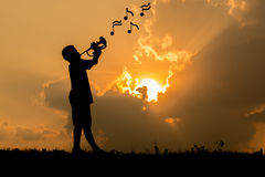 Children playing trumpet Stock Photos