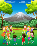 Children playing tug-o-war in the park. Illustration Stock Photo