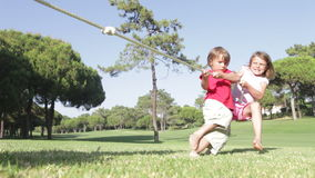 Children Playing Tug Of War stock footage