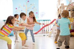 Children playing tug of war royalty free stock images