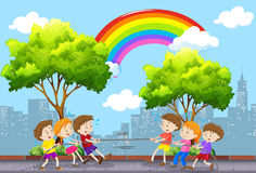 Children playing tug of war in the park. Illustration Stock Images