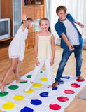 Children playing at twister Stock Photo