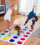 Children playing at twister Stock Images