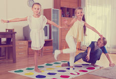 Children playing at twister Royalty Free Stock Image