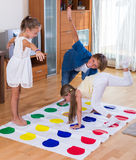 Children playing twister at home Royalty Free Stock Photography