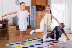 Children playing twister at home Royalty Free Stock Photos