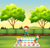 Children playing twister in the park Stock Photos