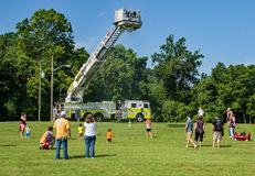 Children Playing under a Firemen's Water Sprayer royalty free stock photo