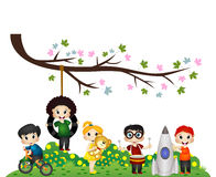 Children playing under a tree branch Stock Photo