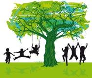 Children playing under a tree