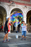 CHILDREN PLAYING IN VENICE Stock Photo