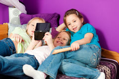 Children playing video games Royalty Free Stock Photography