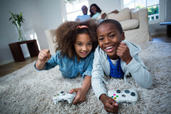Children playing video games. At home Stock Photo