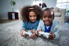 Children playing video games. At home Royalty Free Stock Images