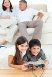 Children playing videogames Royalty Free Stock Image