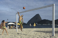 Children playing volley-ball on a beach in Rio de Janeiro, Brazi Royalty Free Stock Images