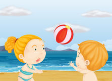 Children playing volleyball at the beach Stock Images