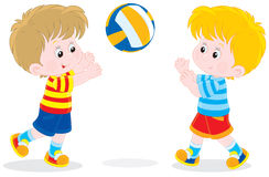 Children playing volleyball Stock Images