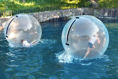 Children Playing in the water ball Royalty Free Stock Photos