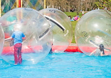 Children playing in water ball Royalty Free Stock Photography