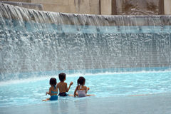 Children playing in the water Royalty Free Stock Image