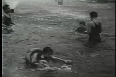 Children playing in water in park, New York City, 1930s stock footage
