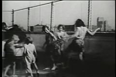 Children playing with water on rooftop, New York City, 1930s stock video footage