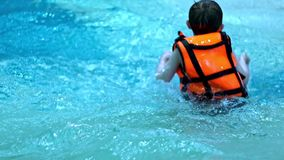 Children playing in water swimming pool slow motion. Child in swimming pool stock video
