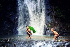 Children playing in waterfall.The refreshing of the israel child royalty free stock images