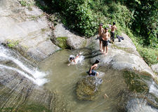 Children playing in a waterfall. In the Sa Pa Valley, Vietnam Stock Images